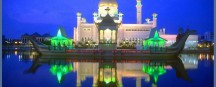 BWN Brunei Bandar Seri Begawan Omar Ali Saifuddien Mosque with stone boat and lagoon by night b
